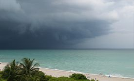 A beautiful beach with a cloudy storm