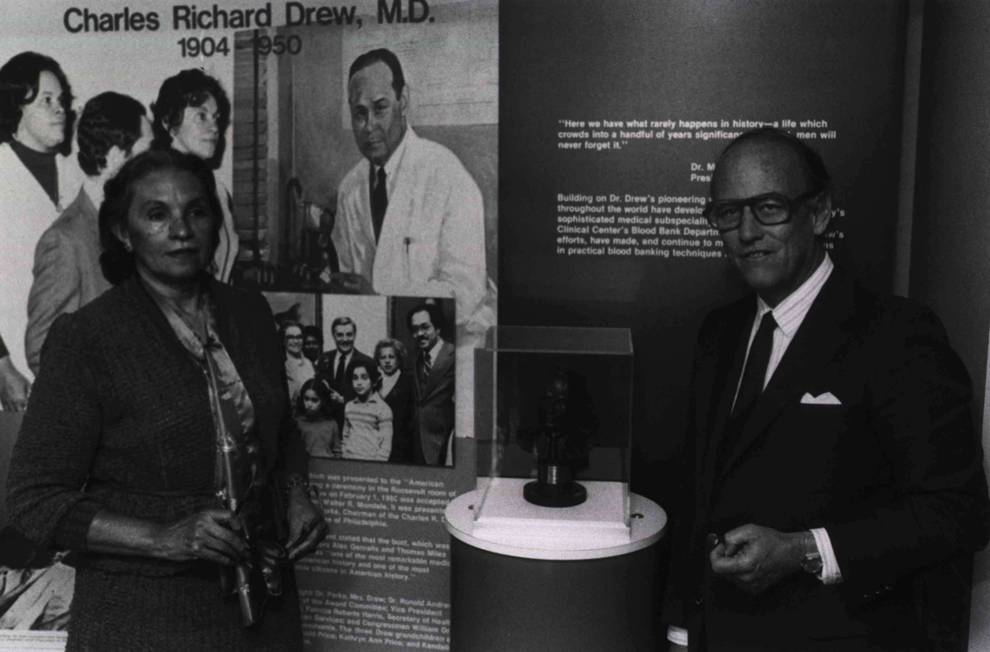 Minnie Lenore Robbins with NIH Director, Donald Frederickson at unveiling of a bust and exhibit of her late husband, Charles Drew.