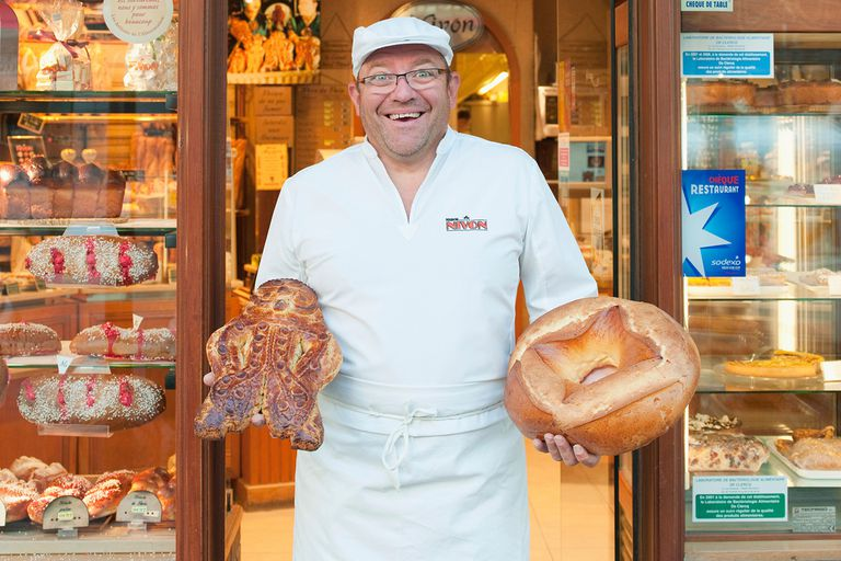 Baker showing his handmade bread