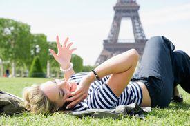 Woman talking on cellphone in Paris