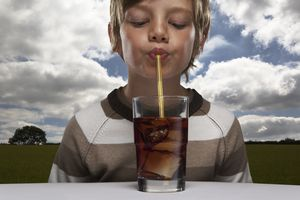 If you drink soda through a straw, you'll minimize contact with teeth and lessen damage and risk of tooth decay.