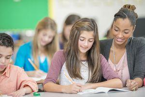 Teacher Helping a Student with a Homework Question
