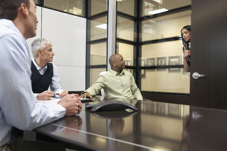 woman entering conference room to interrupt meeting