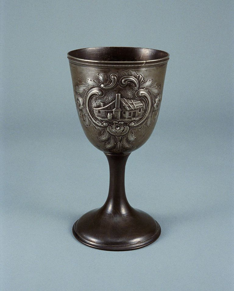Pewter Goblet against blue background.