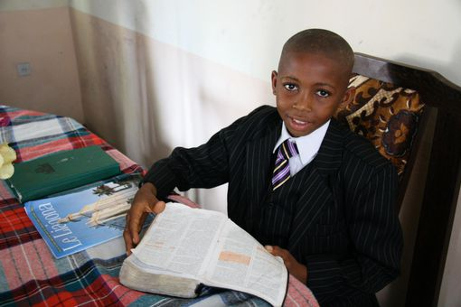 Young boy studying the Bible