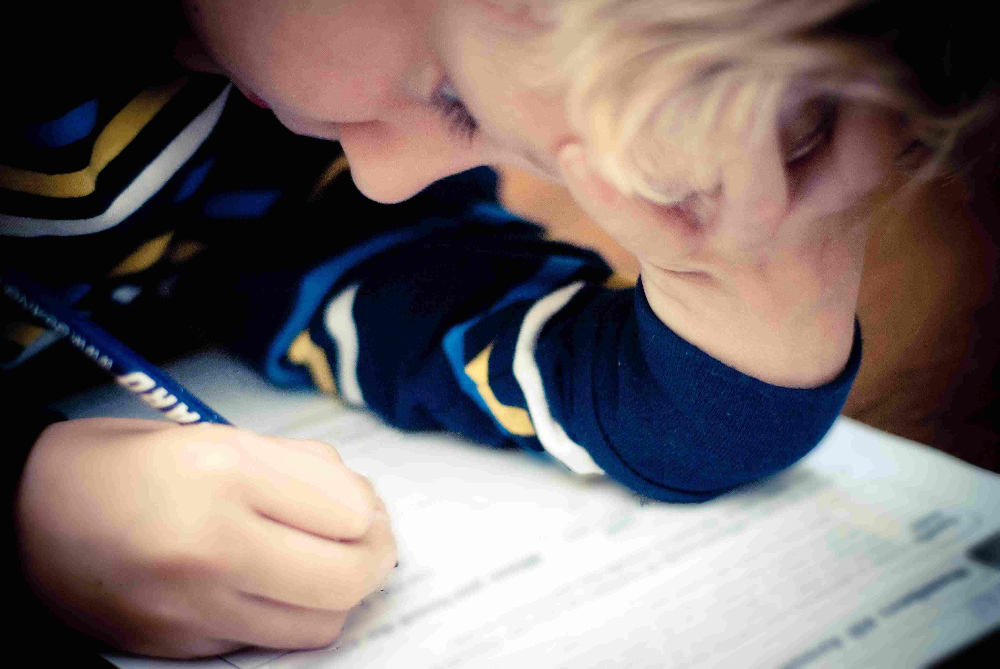 A boy completes a school worksheet