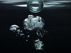 oxygen bubbles floating underwater