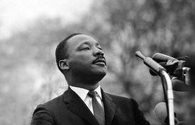 Dr. Martin Luther King, Jr. speaking before crowd of 25,000 Selma to Montgomery, Ala., civil rights marchers, 1965