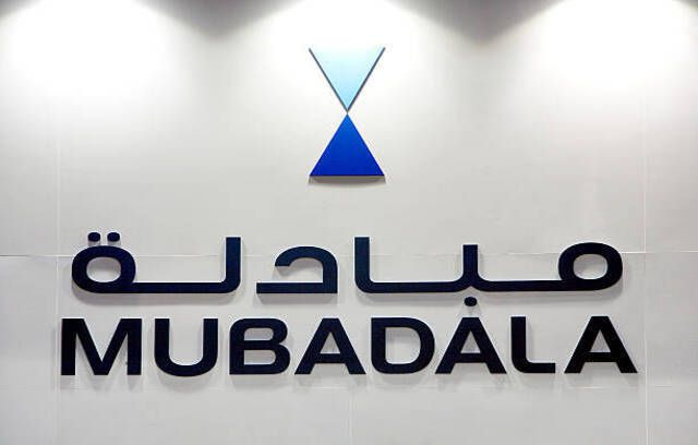 Mubadala Development Co.'s logo displayed at their exhibition booth during the Singapore Airshow in Singapore