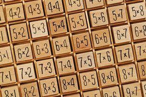 Wooden blocks forming multiplication tables