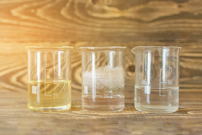 three glass beakers with liquids