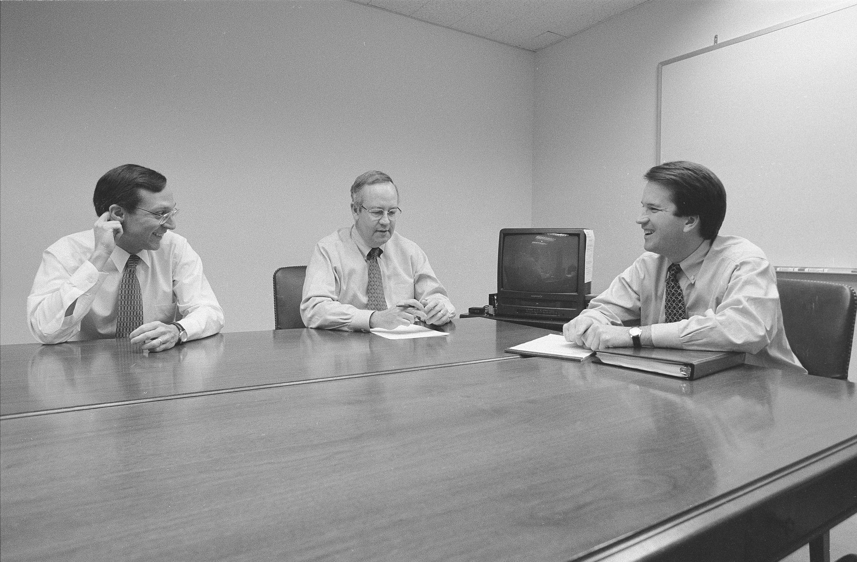 Independent Counsel Kenneth Starr, center, talks with Deputy Independent Counsel John Bates, left, and aide Brett Kavanaugh, right, and another colleague in the Office of the Solicitor General during the Whitewater Investigation on November 13, 1996 in Washington DC