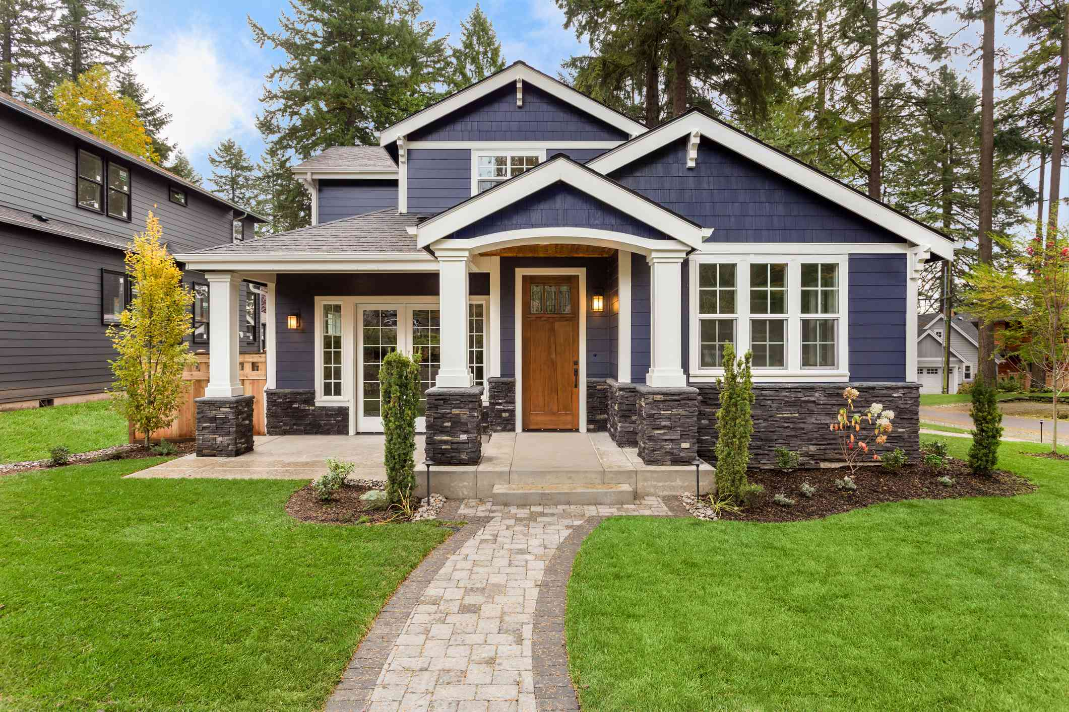 Beautiful Luxury Home Exterior with Green Grass and Landscaped yard
