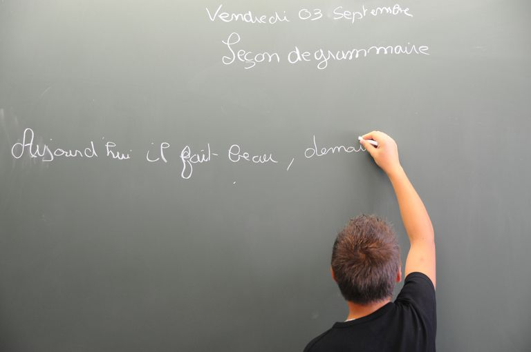 French teacher writing the phrase