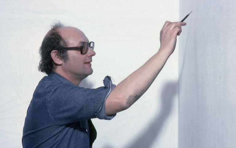 Sol Lewitt creating wall drawing at MOMA (1978)