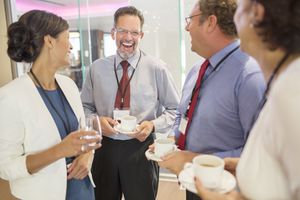 People in lobby of conference center during coffee break