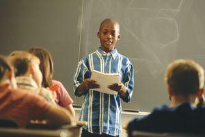 Boy presenting a report