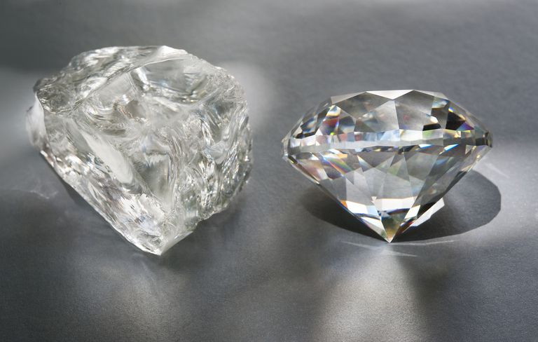 Close-up of rough diamond next to cut diamond