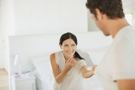 A woman beckons a man over to her