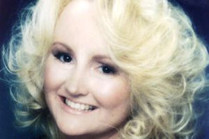 Bonny Lee Bakley smiles warmly in a PR photo, surrounded by angelic blond curls