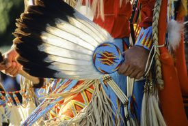 Indigenous person ritual with eagle feathers