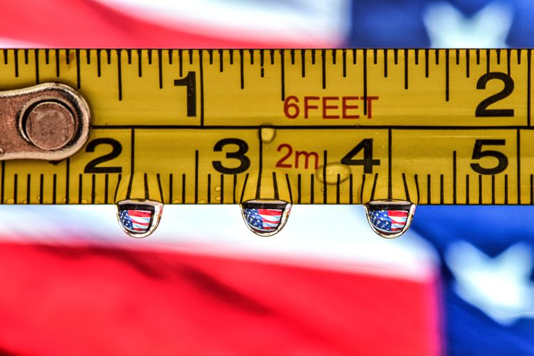 A measuring tape showing where six feet and two meters nearly meet