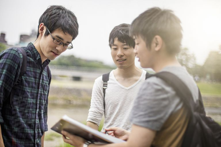 Japanese students looking at a school document