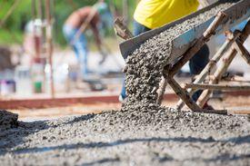 Concrete pouring at construction site