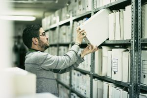 Man looking at files in a storage room