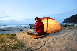 woman traveling abroad on her computer
