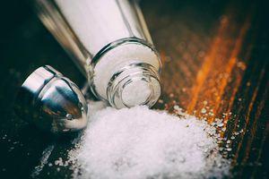 Close-Up Of Salt Shaker Spilled On Table