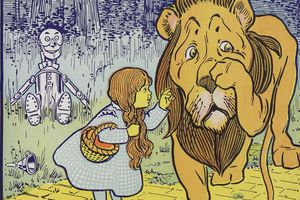 An illustration from the Wizard of Oz depicting Dorothy, the Cowardly Lion, and the Tin Man