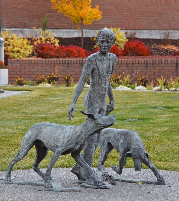 "Statue of characters in ""Where The Red Fern Grows"" at the Public Library in Idaho Falls, Idaho."