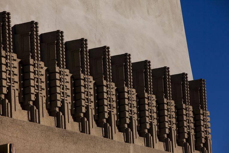 Detail of exterior of Hollyhock House, 10 sculpted abstract hollyhocks along a concret wall