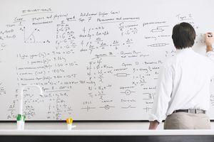 Male teacher writing on whiteboard