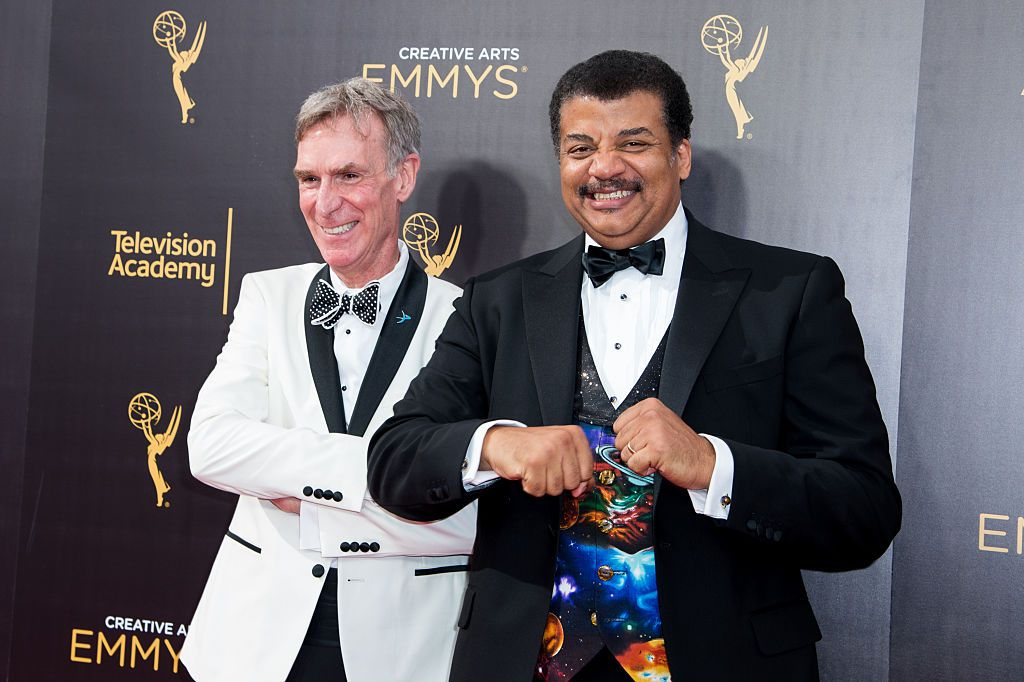 Neil deGrasse Tyson and Bill Nye (left) arrive at the Creative Arts Emmy Awards at Microsoft Theater on September 10, 2016 in Los Angeles, California.