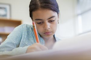 adolescent girl writing