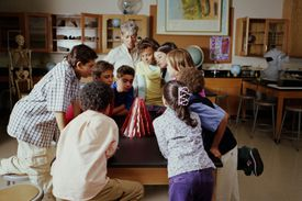 Students and their teacher watch a volcano school science project