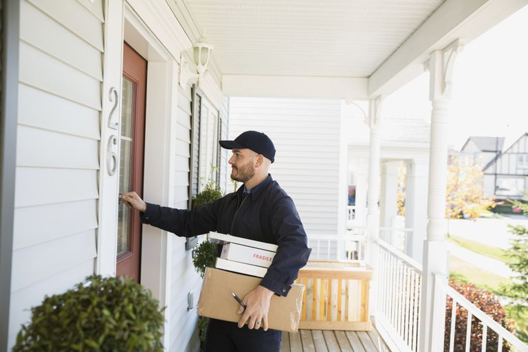 Delivery man knocking on door to see if anyone is home