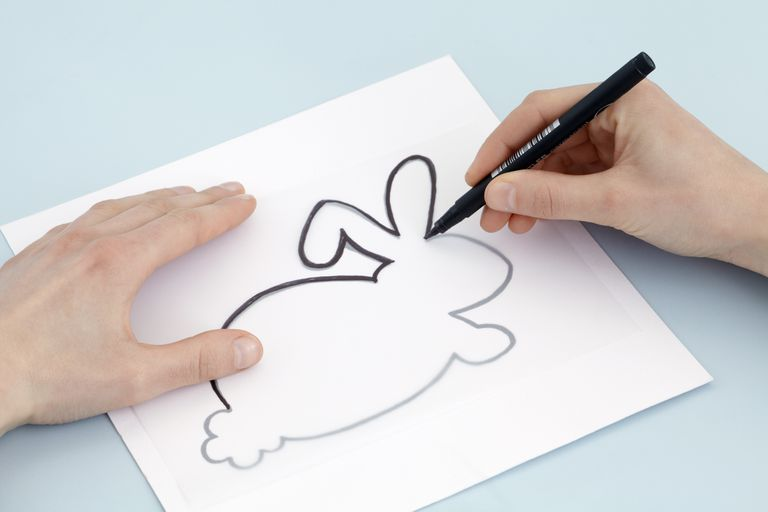 Drawing rabbit design on tracing paper