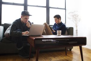 Two Men Studying in a Loft Studio Apartment