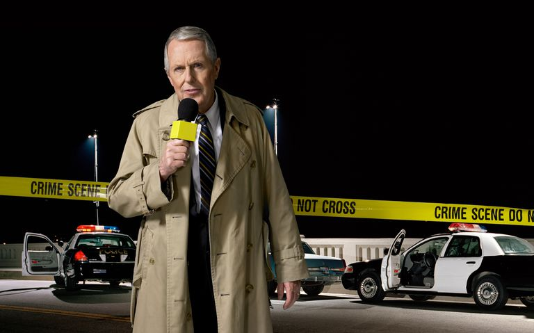 News presenter at crime scene