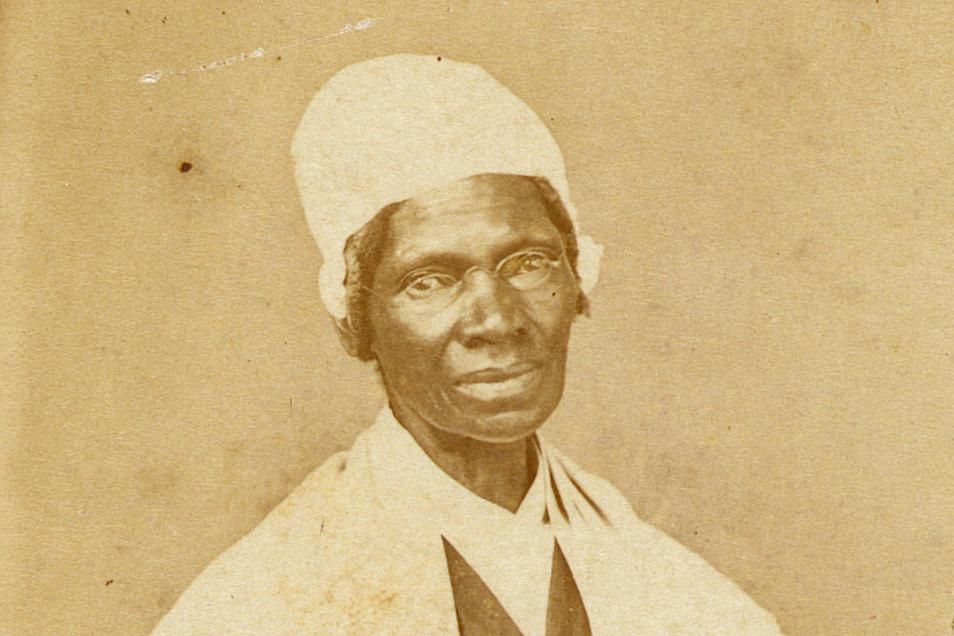 Sojourner Truth at table with knitting and book