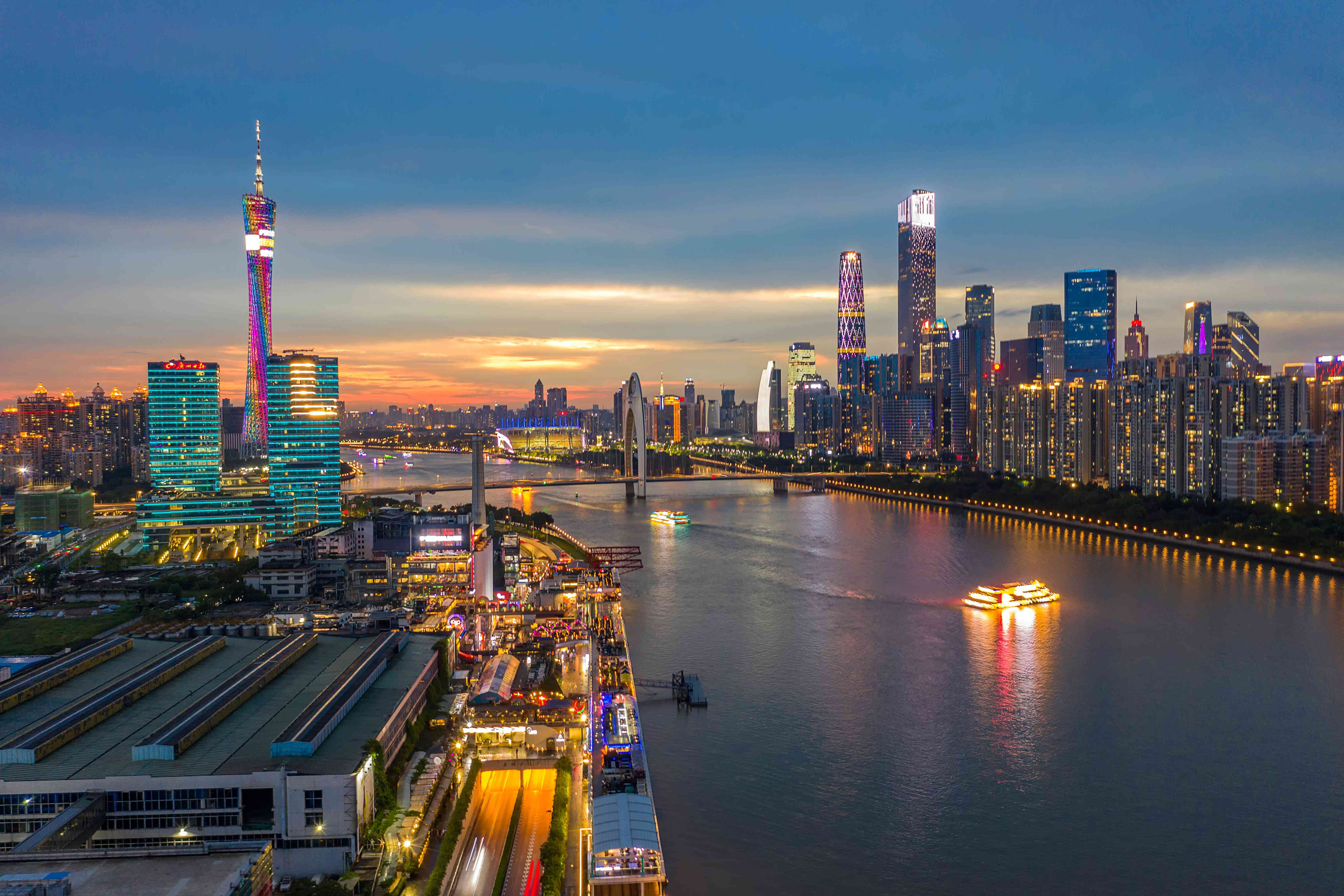 Both sides of the Pearl River in Guangzhou lit up at sunset