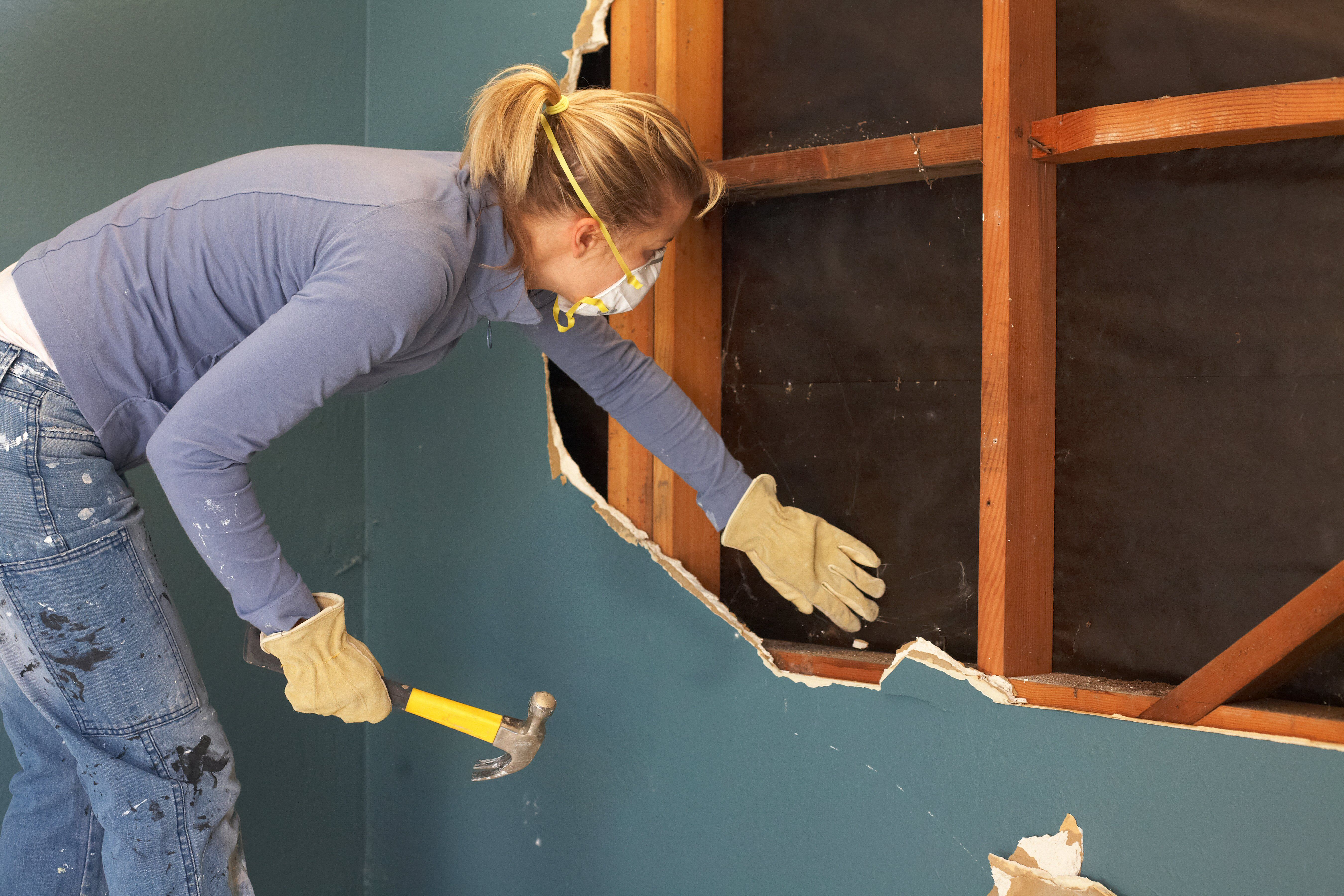Woman doing demolition and construction at home