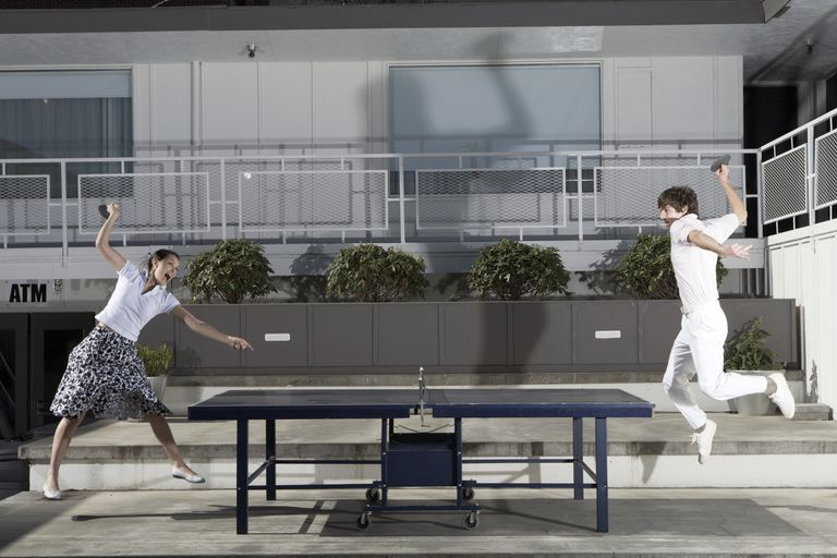 Couple playing ping-pong