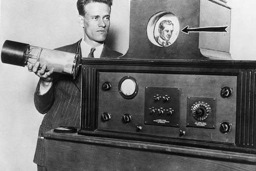Photograph of inventor Philo T. Farnsworth displaying his television