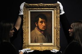 Employees pose with a painting by French artist Edgar Degas entitled