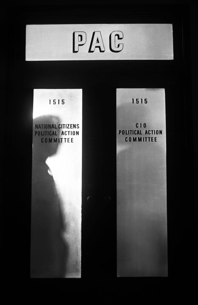 PAC makes a bold showing at the entrance to the C.I.O.'s Political Action Committee headquarters in New York City.