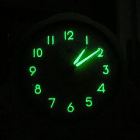 This is a glowing radium painted dial from the 1950s.